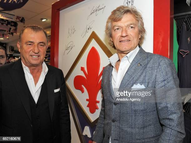 Fatih Terim current Turkish national football manager and former head coach of ACF Fiorentina poses with Giancarlo Antognoni of Fiorentina as he...