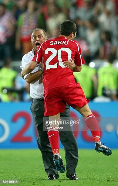 Fatih Terim head coach of Turkey and Sabri Sarioglu celebrate after Semih Senturk scores in the last minute of extra time during the UEFA EURO 2008...