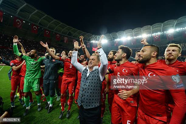 Fatih Terim Turkish association football manager and the Turkey's players celebrate their victory over Iceland during the UEFA Euro 2016 qualifying...