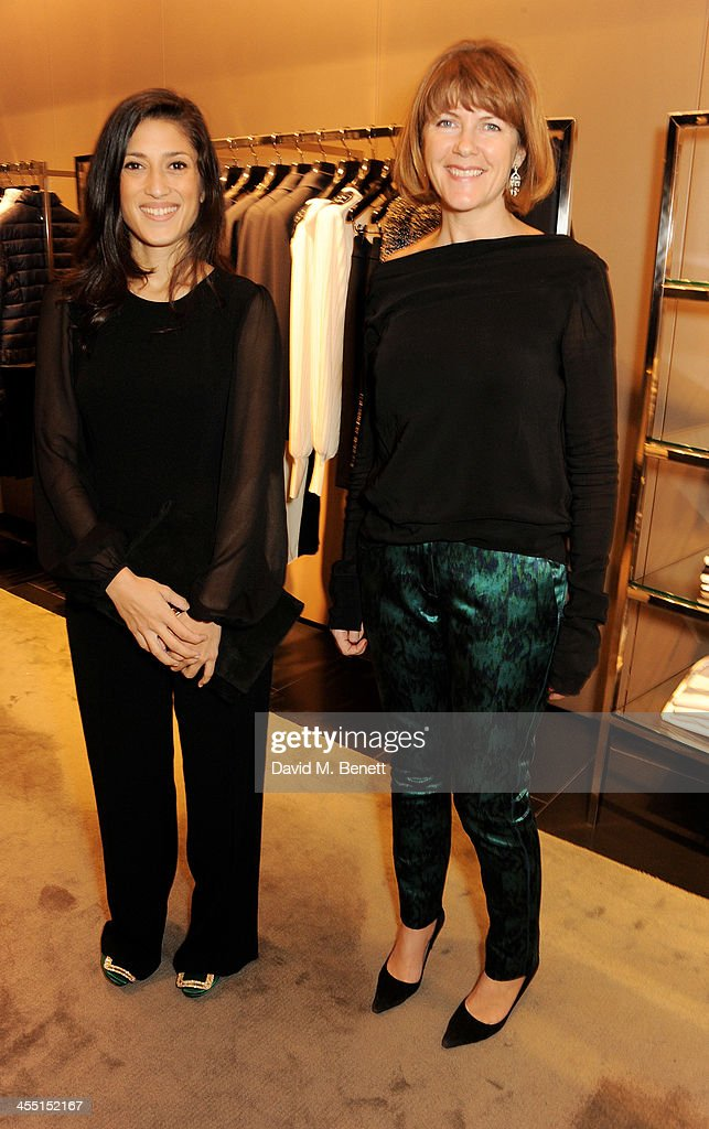 Fatima Bhutto (L) and Harper's Bazaar Digital and Development editor Sacha Bonsor attend the ESCADA/Harper's Bazaar book reading with Fatima Bhutto, reading from her novel 'The Shadow Of The Crescent Moon', at the ESCADA Knightbridge boutique on December 11, 2013 in London, England.