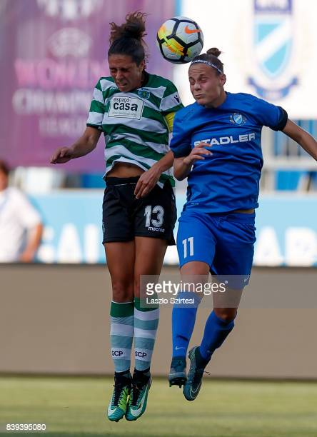 Fatima Pinto of Sporting CP battles for the ball in the air with Dora Papp of MTK Hungaria FC during the UEFA Women's Champions League Qualifying...