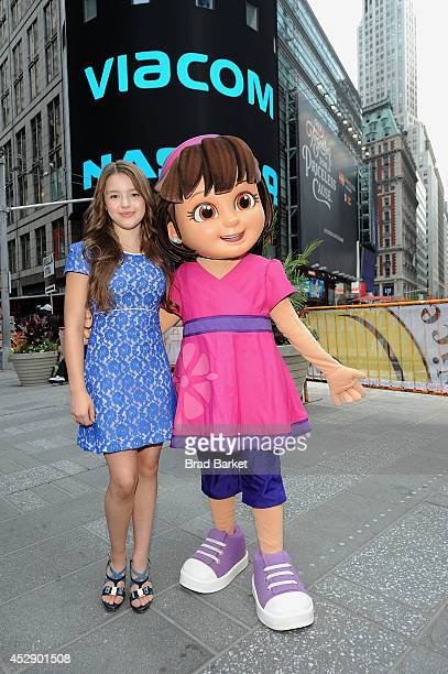 Fatima Ptacek and Dora pose for a photo at the NASDAQ Stock Market Closing Bell in Times Square at NASDAQ on July 29 2014 in New York City