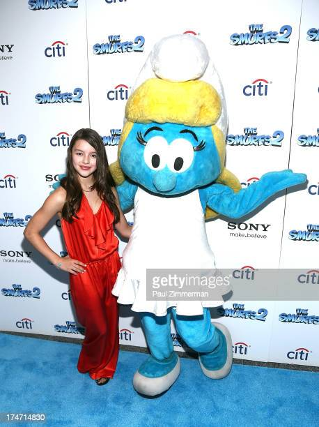 Fatima Ptacek and Smurfette attend 'The Smurfs 2' New York Blue Carpet Screening at Lighthouse International Theater on July 28 2013 in New York City