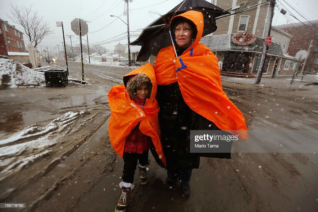 Fatima Quentiro walks with her granddaughter Galalea Castro through the snow to a bus stop to take a bus to Quenitro's home after Castro's home was damaged by flooding as a Nor'Easter approaches in the Rockaway neighborhood on November 7, 2012 in the Queens borough of New York City. The two are wearing jackets donated by the NYC Marathon. The Rockaway Peninsula was especially hard hit by Superstorm Sandy and some are evacuating ahead of the coming storm.
