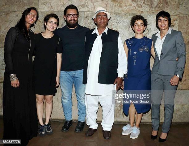 Fatima Sana Shaikh Aamir Khan Wrestler Mahavir Singh Phogat actor Sanya Malhotra and Wrestler Babita Kumari during the special screening of film...