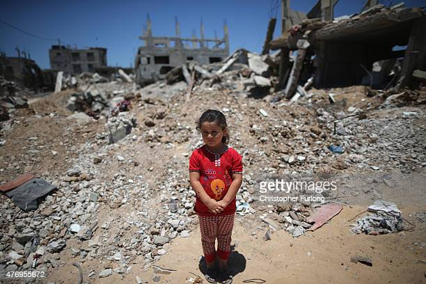 Fatima Shamaly aged four stands amongst the devastation and rubble during a music workshop for traumatised children The Tamer Institute uses music...