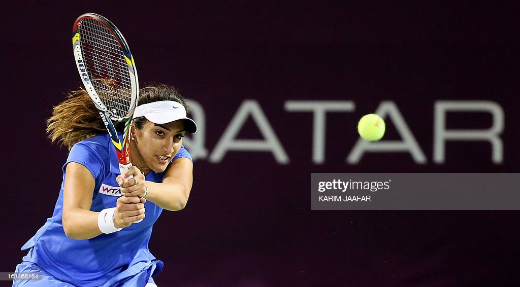 Fatma al-Nabhani of Oman returns the ball to Caroline Garcia of France during their match on the first day of the WTA Qatar Open in the capital Doha, on February 11, 2013.