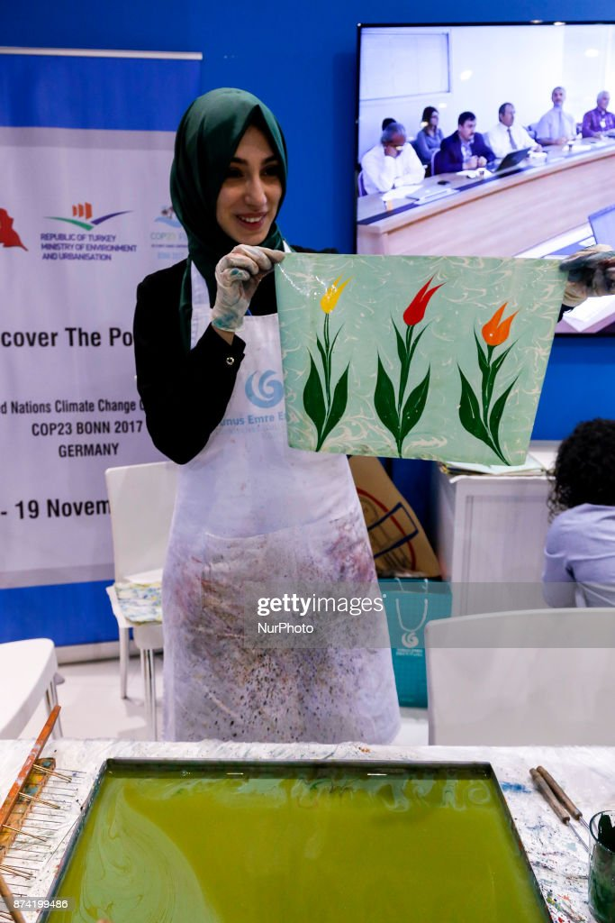 Fatma Beyza Kuluk teaches Ebru art in Turkish Pavilon at the COP23 Fiji conference in Bonn, Germany on the 14th of November 2017. COP23 is organized by UN Framework Convention for Climate Change.