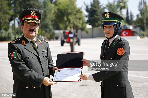 Fatma Rezai the third of the course received her graduation certificate and gift from the Afghanistan General Staff the chief of plans and principles...