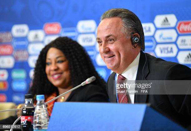 Fatma Samoura FIFA Secretary General looks over at Vitaly Mutko Russian Deputy Prime Minister as he talks to the media during the opening press...
