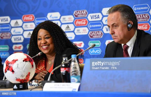 Fatma Samoura FIFA Secretary General talks to the media as Vitaly Mutko Russian Deputy Prime Minister looks on during the opening press conference at...