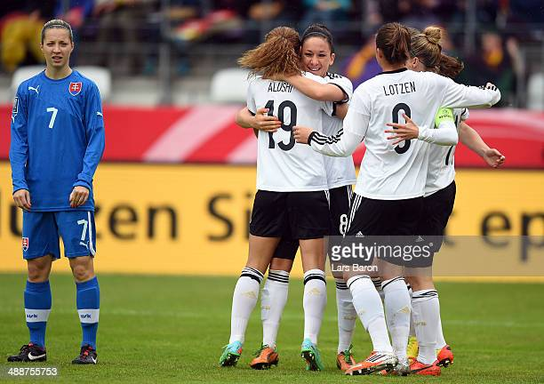 Fatmire Alushi of Grmany celebrates with team mates after scoring his teams first goal during the FIFA Women's World Cup 2015 Qualifier between...
