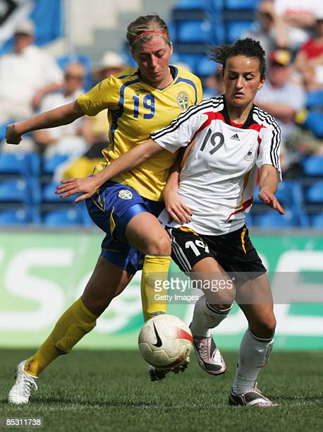 Fatmire Bajramaj and Linda Sembrandt in action during the Women's Algarve Cup match between Germany and Sweden at the Algarve stadium on March 9 2009...