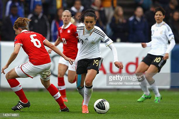 Fatmire Bajramaj of Germany battles for the ball withSelina Kuster of Switzerland during the UEFA Women's EURO Qualifier between Switzerland and...