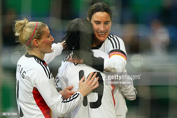 Fatmire Bajramaj of Germany celebrates the first goal with Anja Mittag and Birgit Prinz during the Women's international friendly match between...