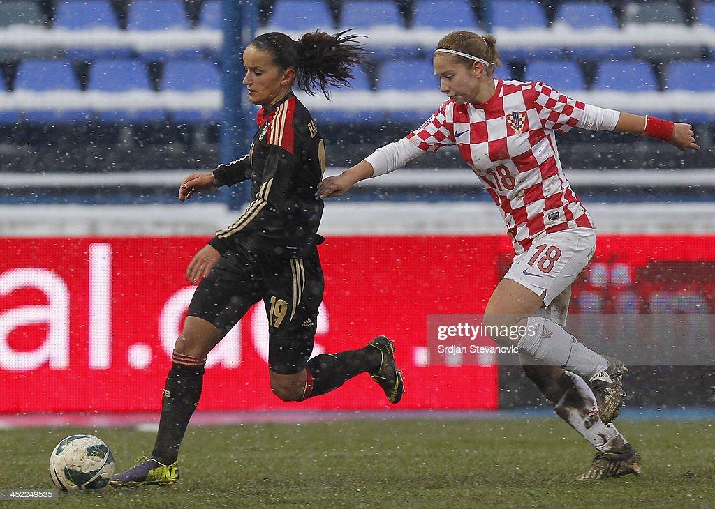 Fatmire Bajramaj (L) of Germany in action against Gabrijela Gaiser (R) of Croatia during the FIFA Women's World Cup 2015 Qualifier between Croatia and Germany at Stadion Gradski Vrt on November 27, 2013 in Osijek, Croatia.