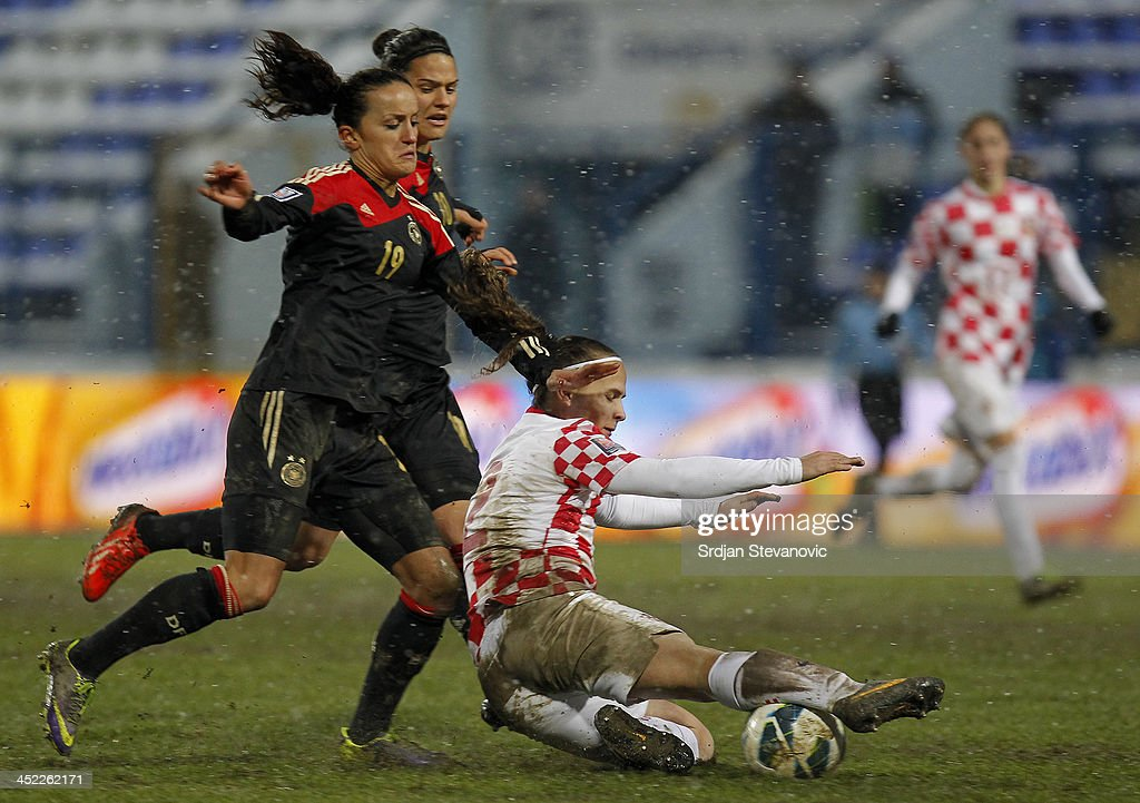 Fatmire Bajramaj (L) of Germany in action against Kristina Nevrkla (R) of Croatia during the FIFA Women's World Cup 2015 Qualifier between Croatia and Germany at Stadion Gradski Vrt on November 27, 2013 in Osijek, Croatia.