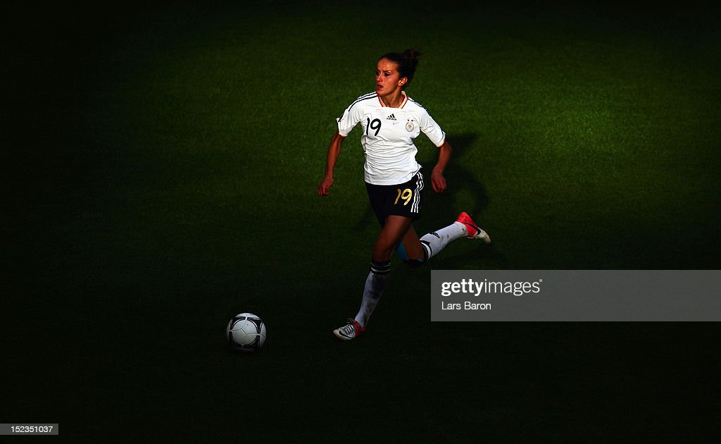 Fatmire Bajramaj of Germany runs with the ball during the UEFA Womens Euro 2013 qualification match between Germany and Turkey at Schauinsland-Reisen-Arena on September 19, 2012 in Duisburg, Germany.