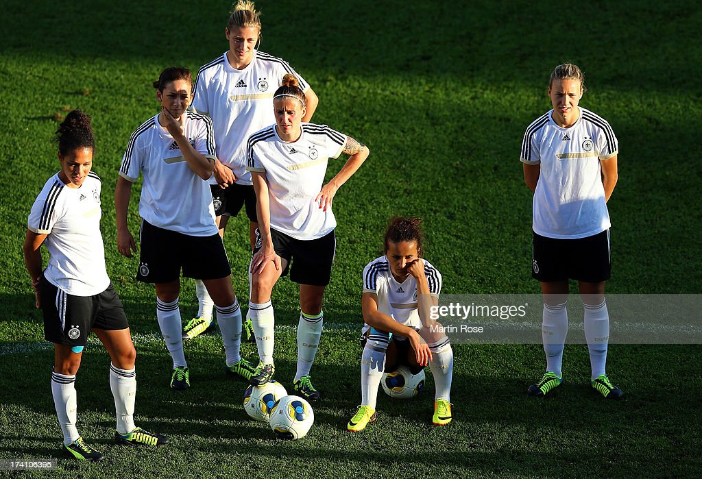 Fatmire Bajramaj (2bd R) reacts during the training session of Germany at Vaxjo Arena on July 20, 2013 in Vaxjo, Sweden.