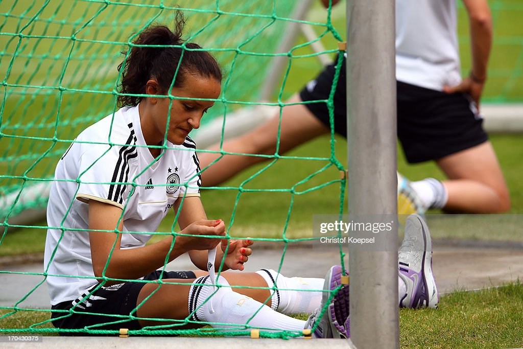 Fatmire Bajramaj tapes her leg during the training session of Women's Team Germany at training ground Ueberruhr on June 13, 2013 in Essen, Germany.
