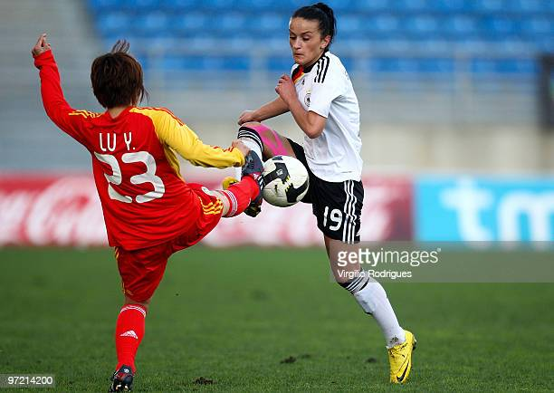Fatmire Bajramal of Germany and Lu Yuan of China battle for the ball during the Woman Algarve Cup match between Germany and China at the Estadio...