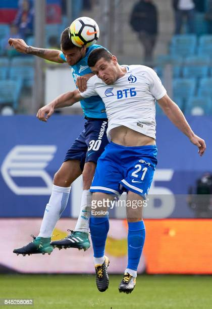 Fatos Beciraj of FC Dinamo Moscow vies for the ball with Emanuel Mammana of FC Zenit SaintPetersbur during during the Russian Premier League match...