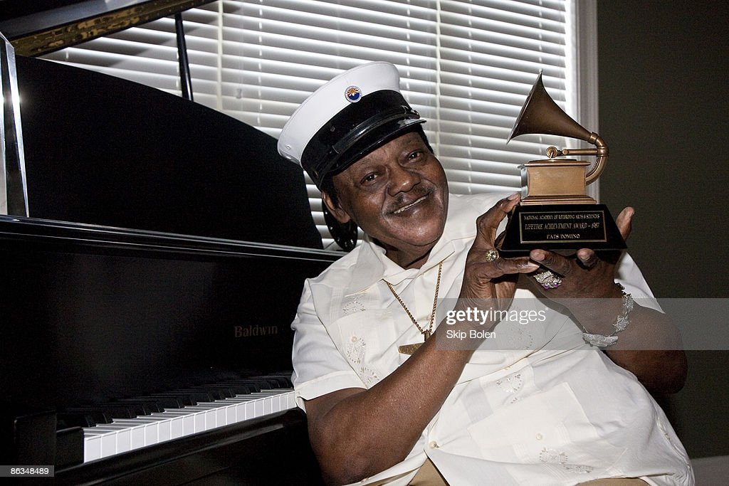 Fats Domino poses after accepting his Grammy Lifetime Achievement Award presented by the Recording Academy's Angelia Bibbs-Sanders at a ceremony to replace Lifetime Achievement Award lost in Hurricane Katrina at Private Residence on May 1, 2009 in New Orleans, Louisiana.