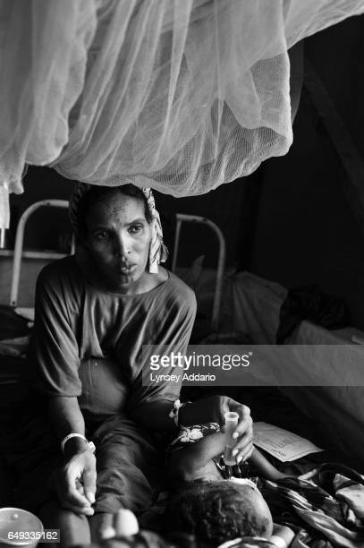 Fatuma Mohammed who is roughly eightmonths pregnant watches over her two severely malnourished daughters in the intensive care section of the...