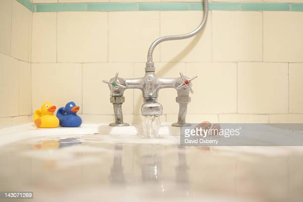 Faucet pouring water into bath tub