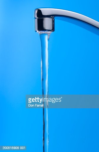 Faucet with stream of water : Stock Photo