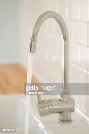 Faucet with water flowing : Stock Photo