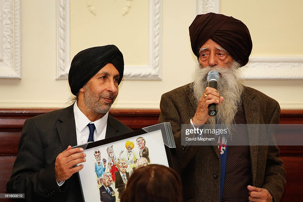 Fauja Singh (R) attends the Oldie of the Year Awards at Simpsons in the Strand on February 12, 2013 in London, England.