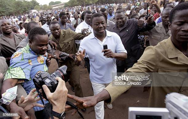 Faure Gnassingbe the son of Togo's late president Gnassingbe Eyadema is greeted by supporters after casting his vote 24 April 2005 in Lome during...