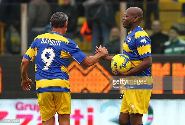 Faustino Asprilla of Stelle Gialloblu celebrates his goal with teammate Massimo Barbuti during the 100 Years Anniversary match between Stelle...
