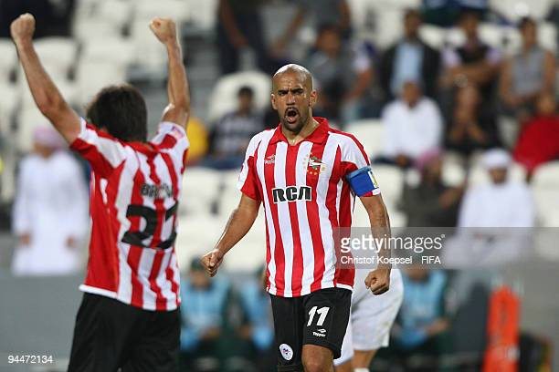 Faustino Rojo of Estudiantes LP and Juan Sebastian Veron celebrate their 21 victory after the FIFA Club World Cup semifinal match between Pohang...