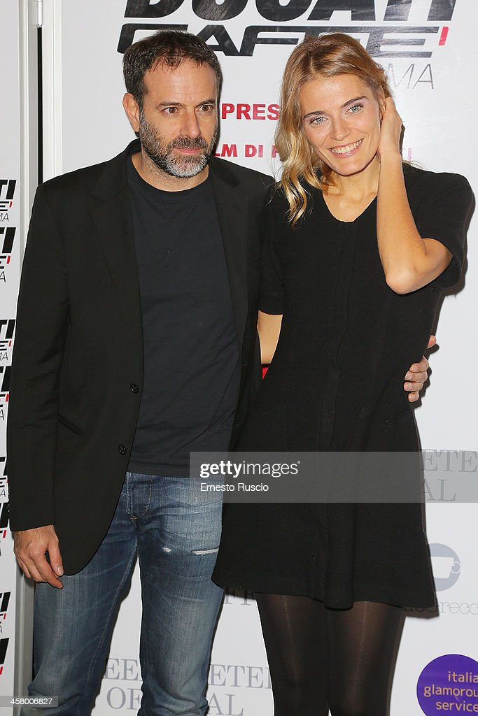 Fausto Brizzi and <a gi-track='captionPersonalityLinkClicked' href=/galleries/search?phrase=Claudia+Zanella&family=editorial&specificpeople=4025345 ng-click='$event.stopPropagation()'>Claudia Zanella</a> attend the 'Indovina Chi Viene A Natale' party at Ducati Caffe on December 19, 2013 in Rome, Italy.