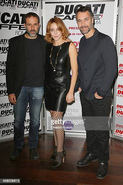 Fausto Brizzi Claudia Gerini and Raul Bova attend the 'Indovina Chi Viene A Natale' party at Ducati Caffe on December 19 2013 in Rome Italy