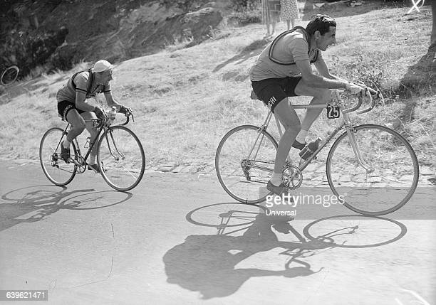 Fausto Coppi and Stan Ockers make their ascent of Puy de Dome in the 21st stage of the 1952 Tour de France | Location Between Limoges and...