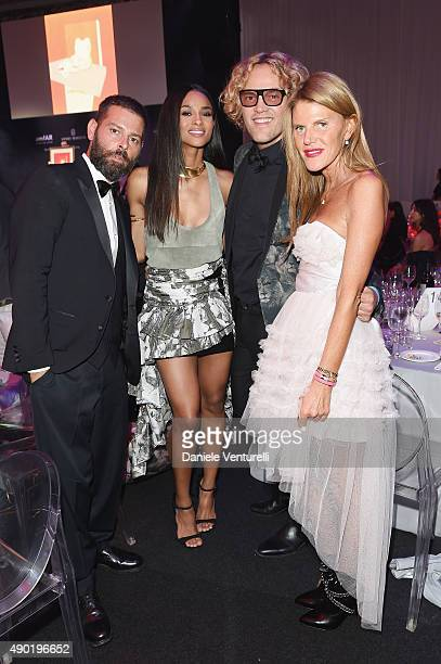 Fausto Puglisi Ciara Peter Dundas and Anna Dello Russo attend the amfAR Milano 2015 after party at La Permanente on September 26 2015 in Milan Italy