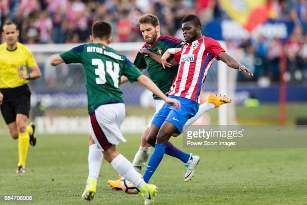 Fausto Tienza Nunez of Osasuna and Thomas Teye Partey of Atletico de Madrid in action during the La Liga match between Atletico de Madrid vs Osasuna...