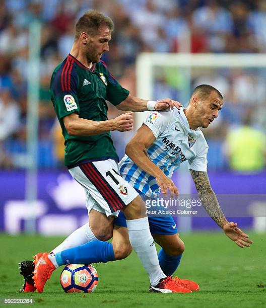 Fausto Tienza of CA Osasuna competes for the ball with Sandro Ramirez of Malaga CF during the match between Malaga CF vs CA Osasuna as part of La...