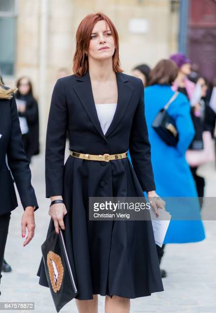 Fauve Hautot wearing a navy coat with golden belt outside Dior on March 3 2017 in Paris France