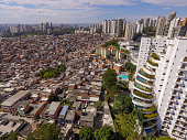 The Paraisópolis Slum, the biggest one in São Paulo city, is next to Morumbi, a rich neighborhood, with high standard residencial buildings.