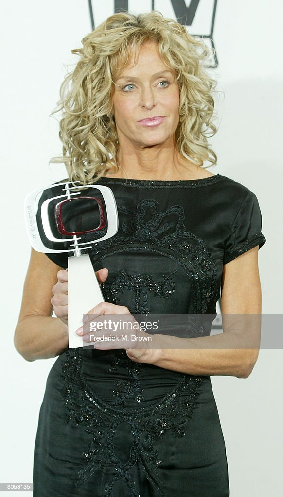 Favourite 'Fan'tastic Phenomenon Winner, Actress Farrah Fawcett poses backstage at the 2nd Annual TV Land Awards held on March 7, 2004 at The Hollywood Palladium, in Hollywood, California.