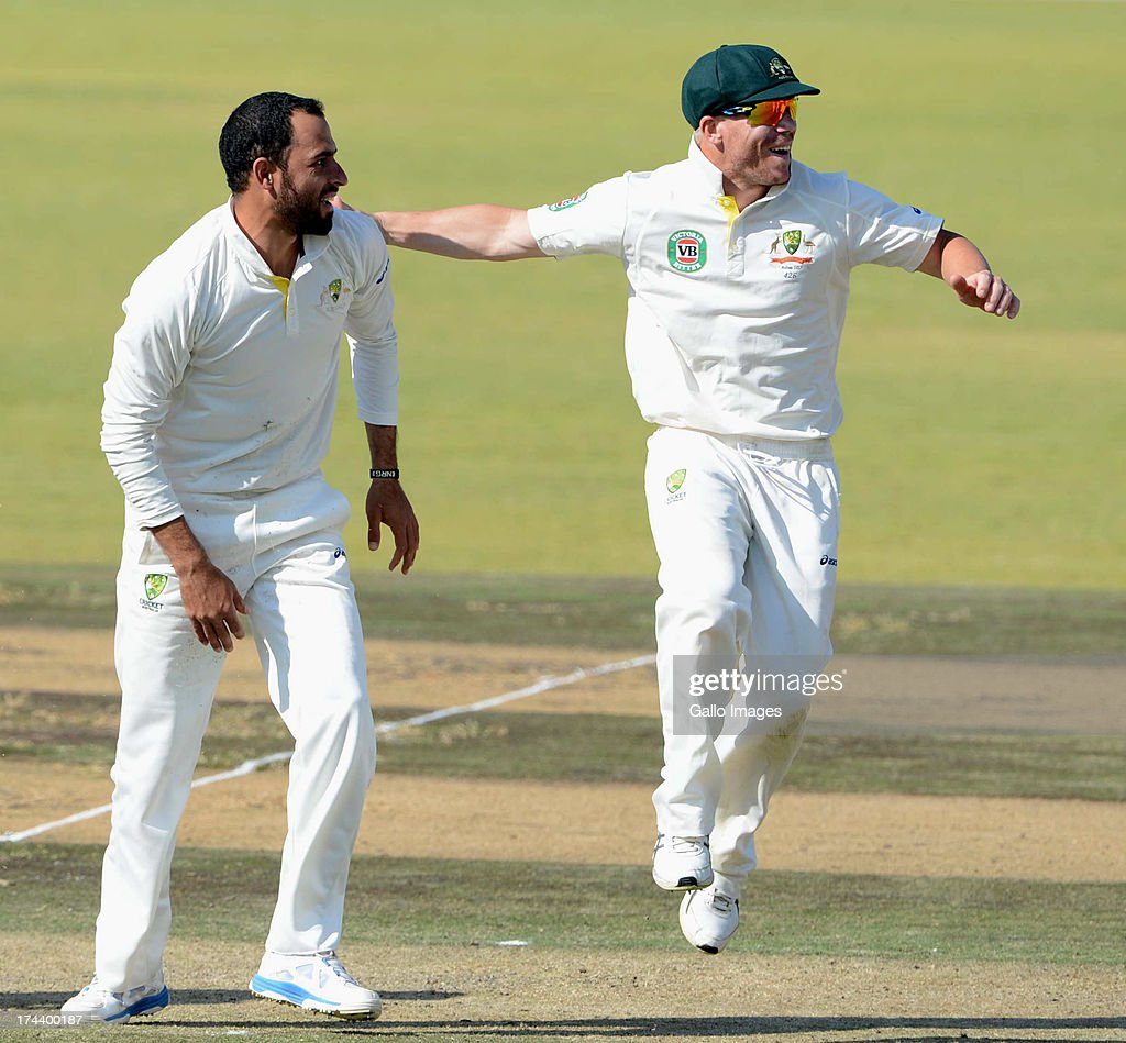 Fawad Ahmed and David Warner of Australia A celebrate the wicket of Rilee Rossouw of South Africa A during day 2 of the 1st Test match between South Africa A and Australia A at Tuks Oval on July 25, 2013 in Pretoria, South Africa.