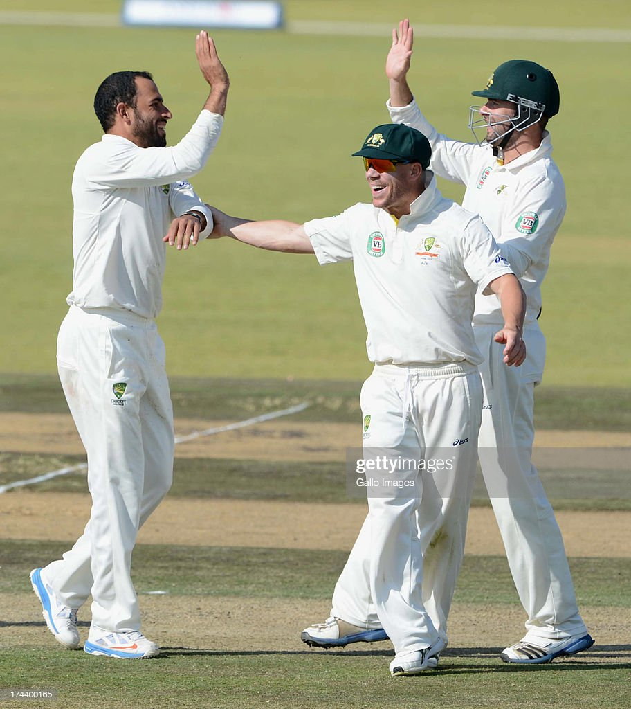 Fawad Ahmed and of Australia A celebrate the wicket of Rilee Rossouw of South Africa A with his team mates during day 2 of the 1st Test match between South Africa A and Australia A at Tuks Oval on July 25, 2013 in Pretoria, South Africa.