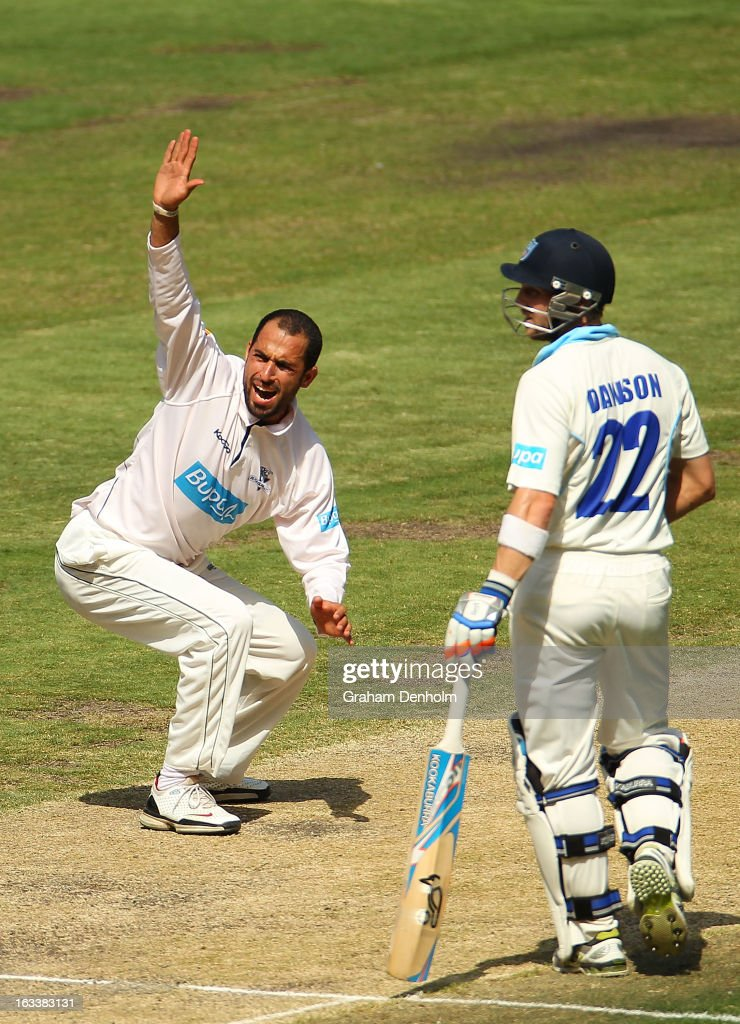 Fawad Ahmed of the Bushrangers (L) appeals to the umpire as David Dawson of the Blues looks on during day three of the Sheffield Shield match between the Victorian Bushrangers and the New South Wales Blues at Melbourne Cricket Ground on March 9, 2013 in Melbourne, Australia.