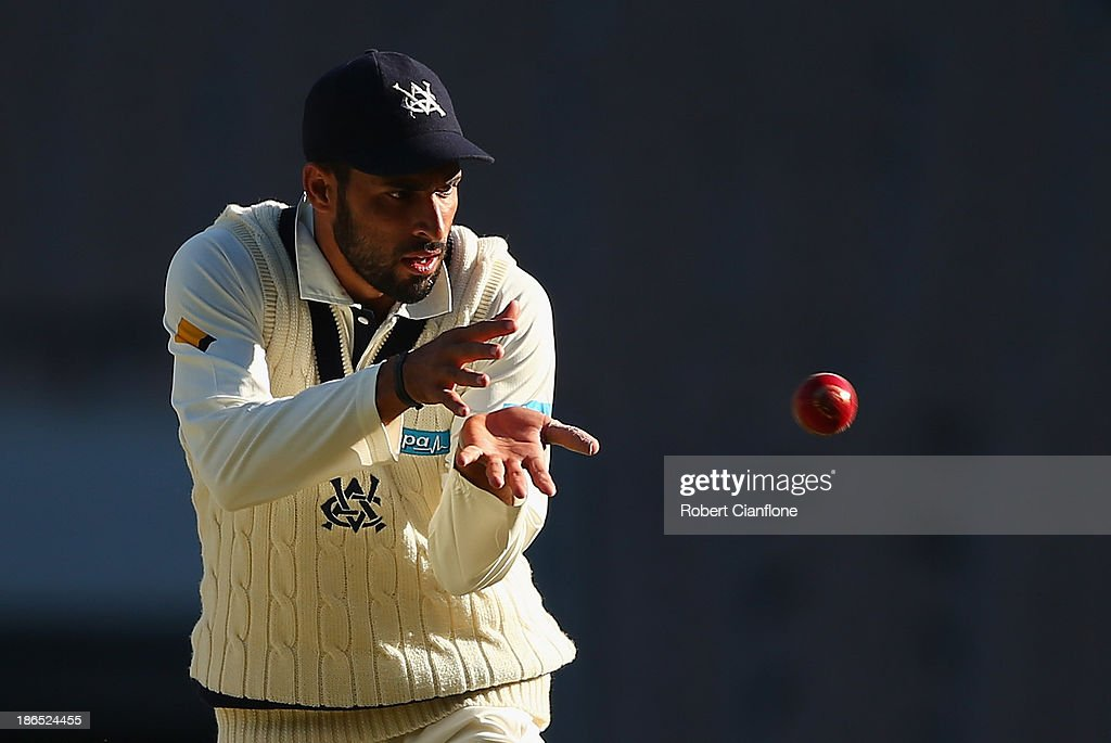 Fawad Ahmed of the Bushrangers fields the ball during day three of the Sheffield Shield match between the Victoria Bushrangers and the Western Australia Warriors at Melbourne Cricket Ground on November 1, 2013 in Melbourne, Australia.