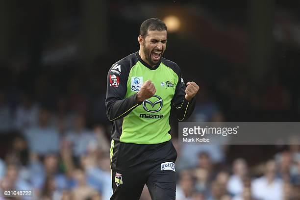 Fawad Ahmed of the Thunder celebrates taking the wicket of Moises Henriques of the Sixers during the Big Bash League match between the Sydney Sixers...