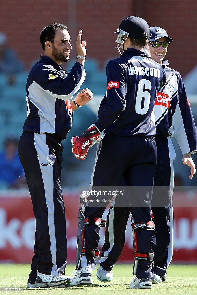 Fawad Ahmed (L) of Victoria celebrates after getting his third wicket for the match during the Ryobi One Cup Day match between the South Australian Redbacks and the Victorian Bushrangers at Adelaide Oval on February 9, 2013 in Adelaide, Australia.